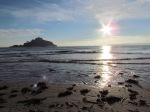 Sun setting on St Michael's Mount